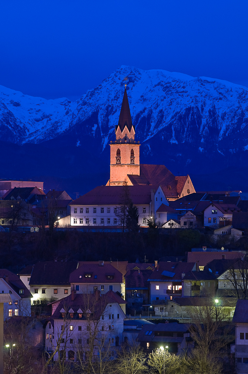 Dusk over Kranj in Slovenia with St. Cantianus Church in the foreground and the Kamnik Alps behind